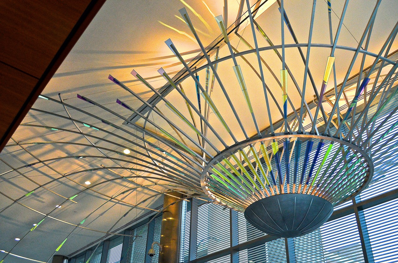 Ed Carpenter's Radius suspended dichroic glass art lobby sculpture emanates outward through the Ann Arbor Justice Center lobby with dichroic glass and concealed lighting. / image 1