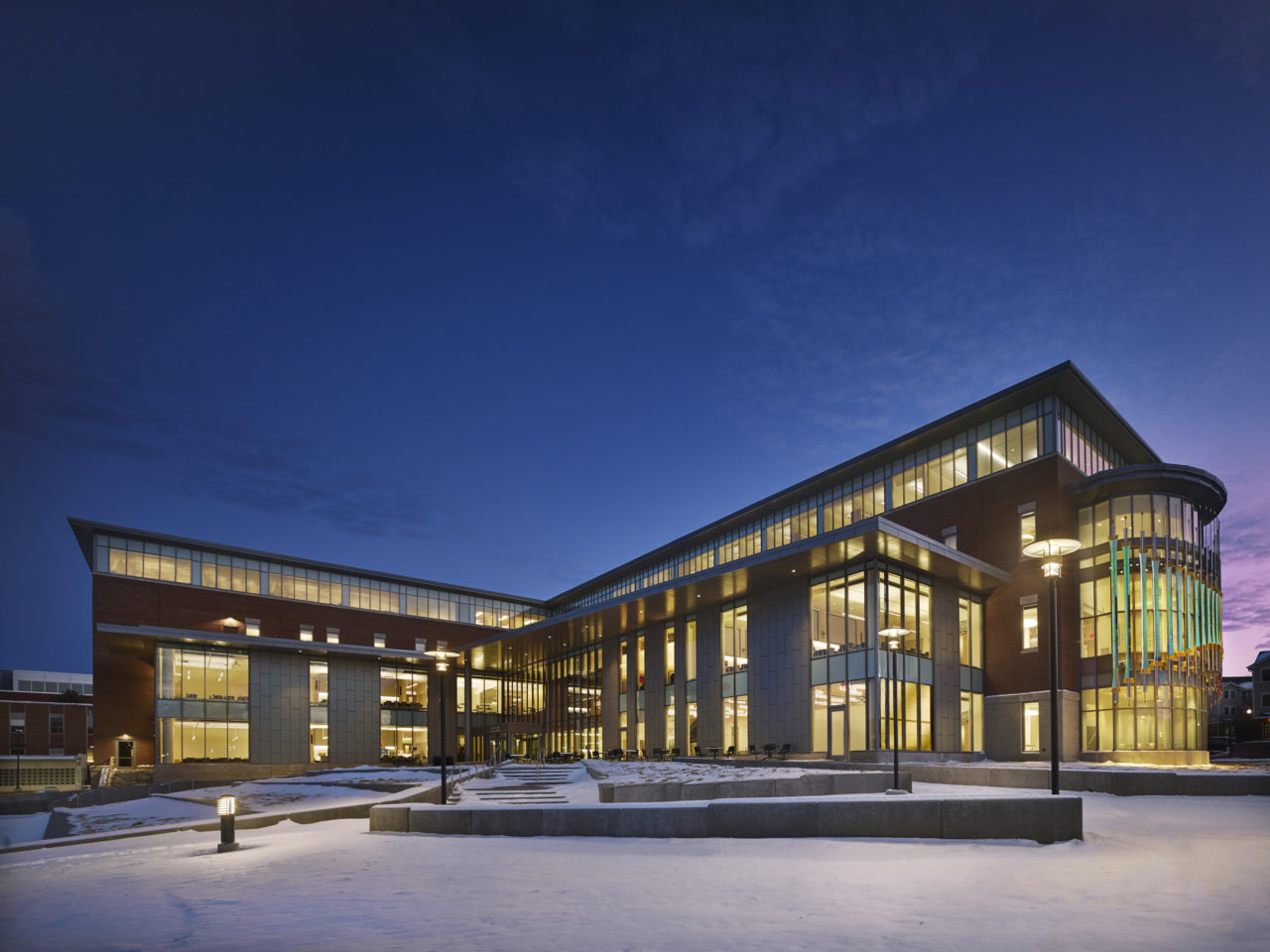 Rohrer College of Business at Rowan University exterior full view with Threshold laminated dichroic glass and perforated stainless steel sculpture at right. / image 1