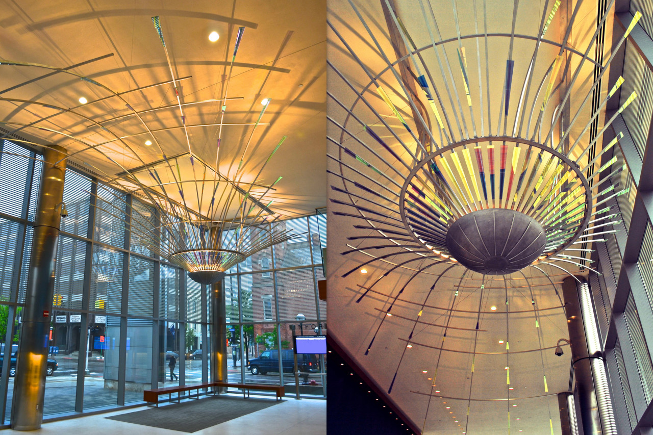 Ed Carpenter's Radius suspended ceiling sculpture emanates outward through the Ann Arbor Justice Center lobby and is designed to involve as much of the lobby as possible, radiating from the southeast corner, visible from inside and outside. / image 2