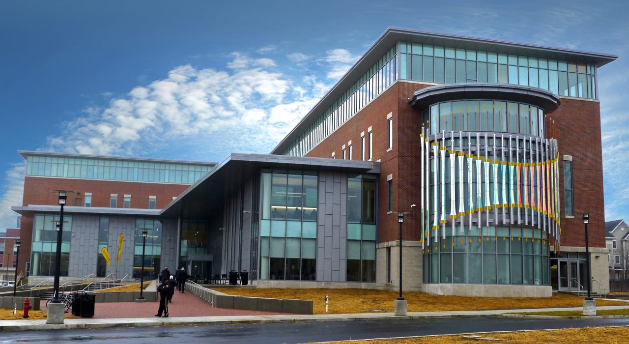 Rohrer College of Business at Rowan University exterior side view with Threshold laminated dichroic glass and perforated stainless steel sculpture at right. / image 2