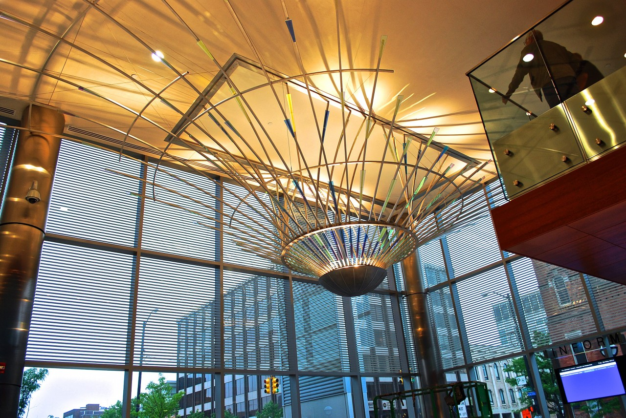 Ed Carpenter's Radius suspended ceiling sculpture emanates outward through the Ann Arbor Justice Center lobby. / image 3