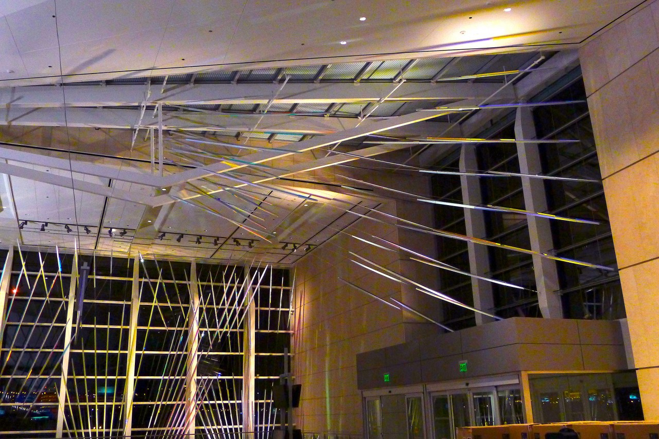 Ed Carpenter's McCarran airport suspended art on the west window wall and adjacent skylight night view. / image 3