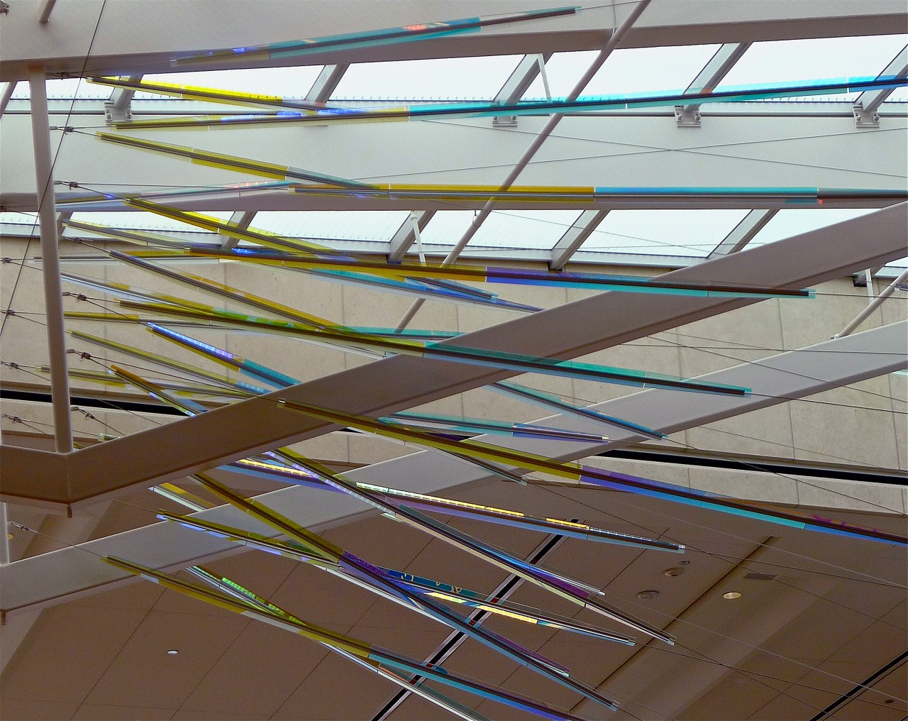 Close up view of Ed Carpenter's McCarran airport skylight art inner layer of cable-mounted glass panels whose colors and reflections transform themselves dramatically from various angles. / image 4