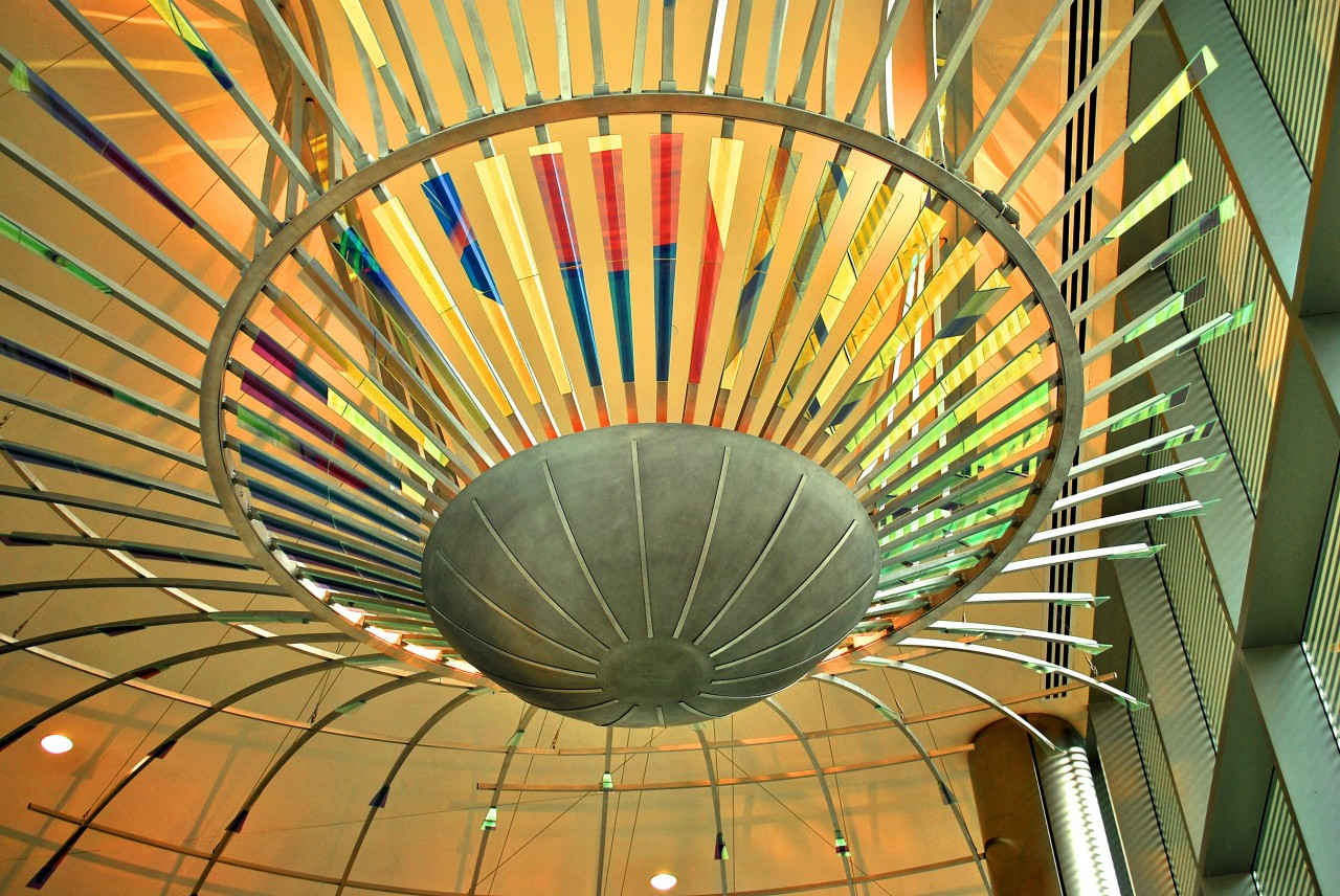 Ed Carpenter's Radius suspended ceiling sculpture emanates outward through the Ann Arbor Justice Center lobby with brilliant dichroic glass elements. / image 4