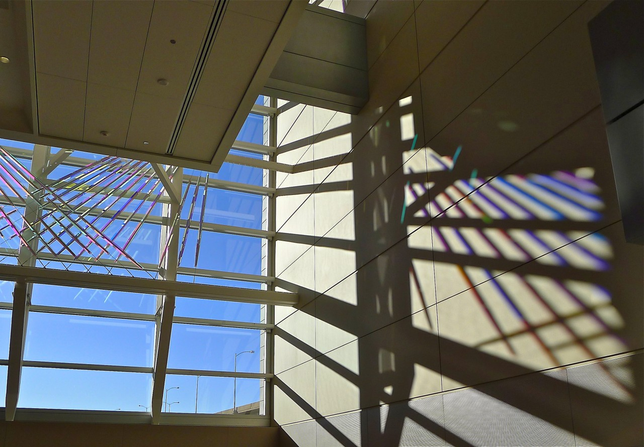 View of Ed Carpenter's McCarran airport skylight art cable-mounted glass panels whose colors and reflections transform themselves dramatically from various angles. / image 7