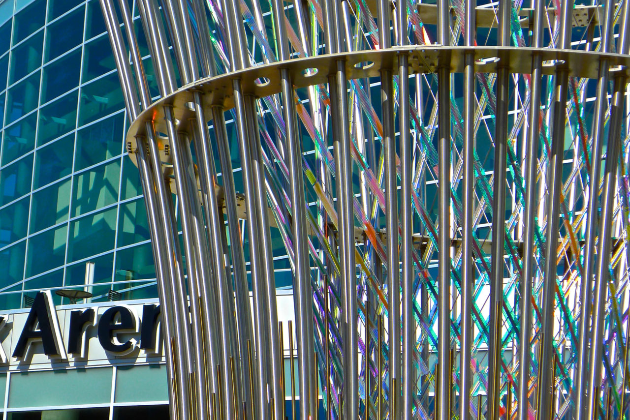 Harvest  monumental public sculpture in Lincoln, Nebraska close up, showing dichroic glass and stainless steel and dichroic glass structural tension elements. / image 8