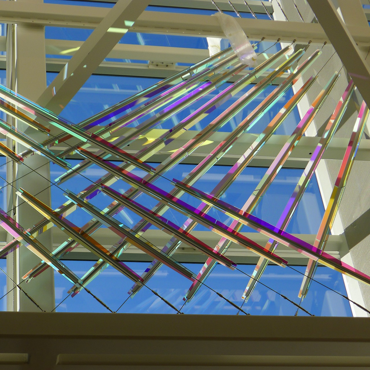 Ed Carpenter's McCarran airport skylight art cable-mounted glass panels - This sculpture spans three levels and consists of a main component at the west curtain wall. / image 8