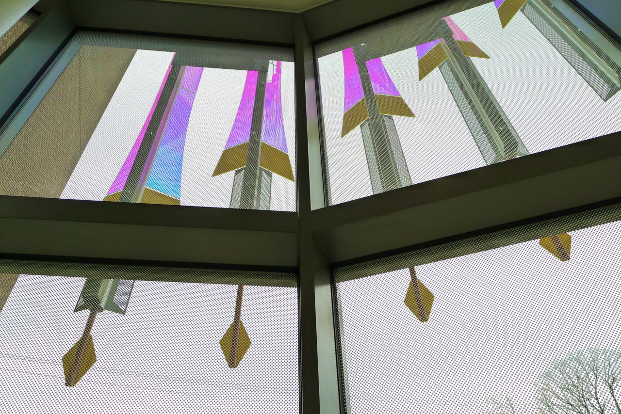 Rohrer College of Business at Rowan University interior view of laminated dichroic glass and stainless steel fin details. / image 8