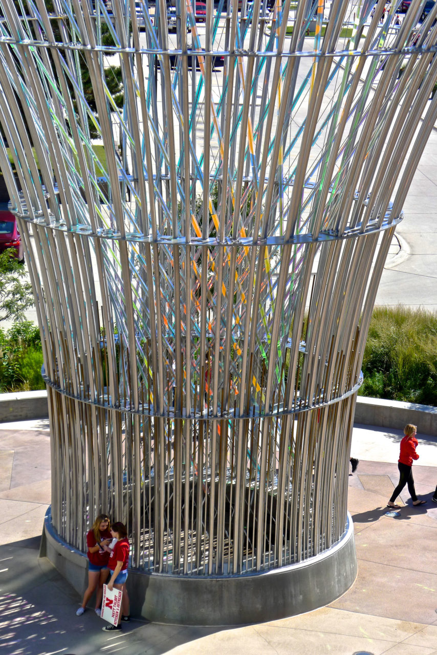 Harvest monumental public sculpture in Lincoln, Nebraska close up, showing dichroic glass and stainless steel elements. / image 9