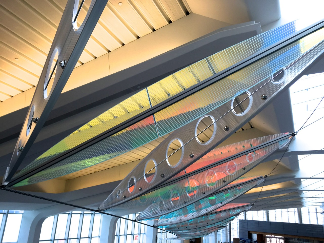 Ed Carpenter's Wichita Dwight D. Eisenhower National Airport signature sculpture Aloft delights travelers with colorful laminated safety dichroic glass above. / image 14