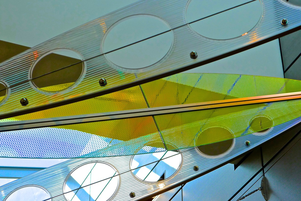 Showing Ed Carpenter's Wichita Dwight D. Eisenhower National Airport signature sculpture Aloft close up of alternating colorful laminated safety dichroic glass and cellular polycarbonate. / image 17