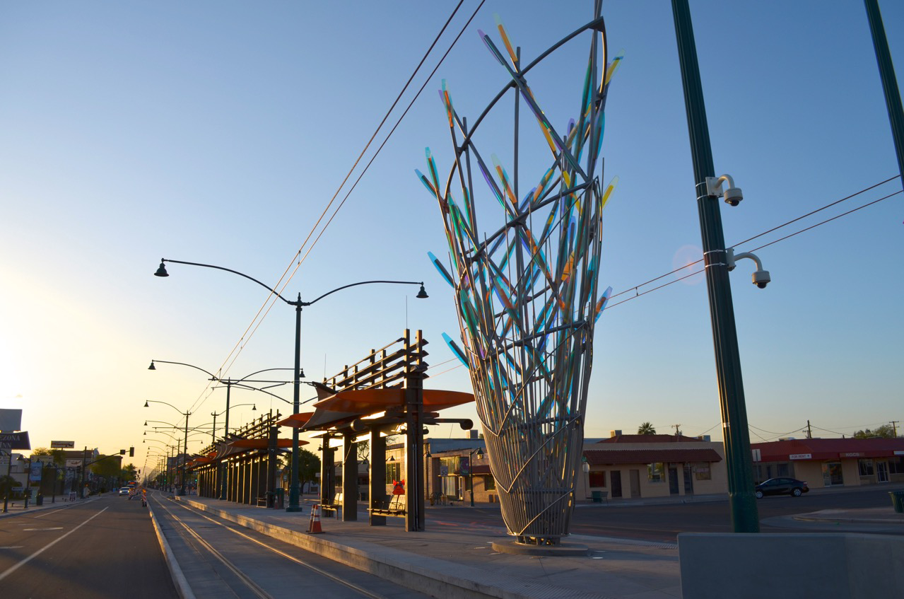 Ed Carpenter's Mesaflora Mesa AZ sculpture in the early morning marks the way for light rail commuters. / image 2