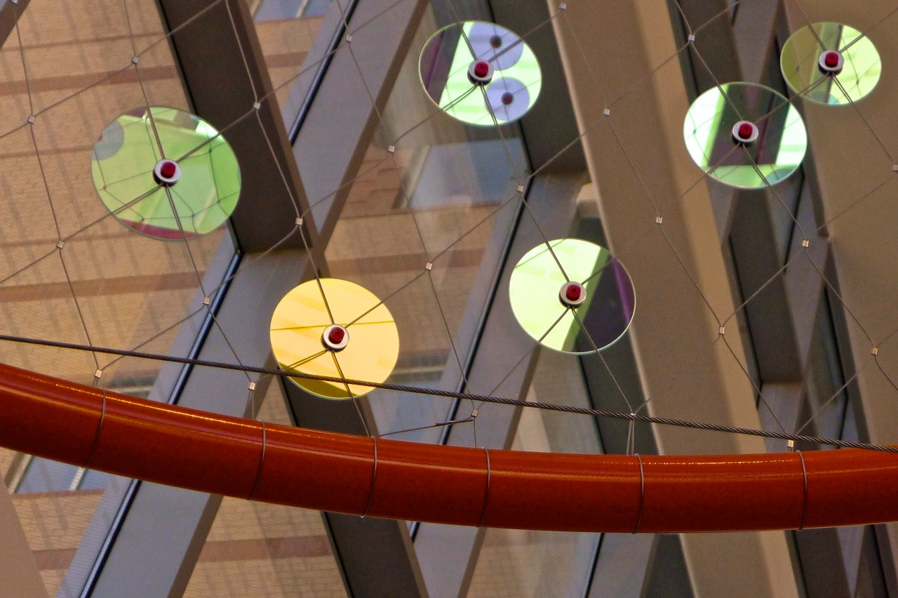 Close up of the dichroic rounds used in Ed Carpenter's Foxglove suspended glass art lobby. / image 7