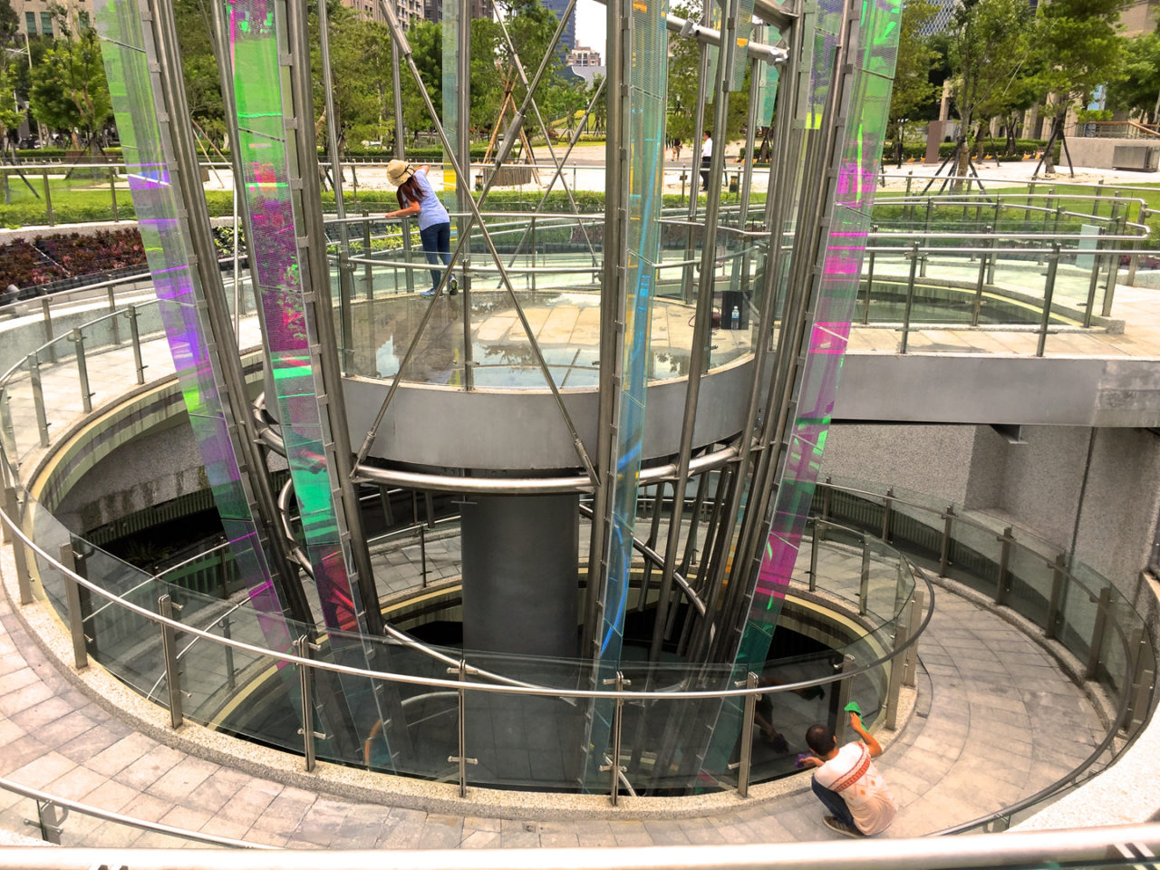 Taichung, Taiwan Civic Center monumental sculpture: Stainless Steel and Laminated Dichroic Glass. Crocus emerges from two levels of parking below the parks, surrounds a viewing platform, and unfolds upward like an enormous blossom. / image 7