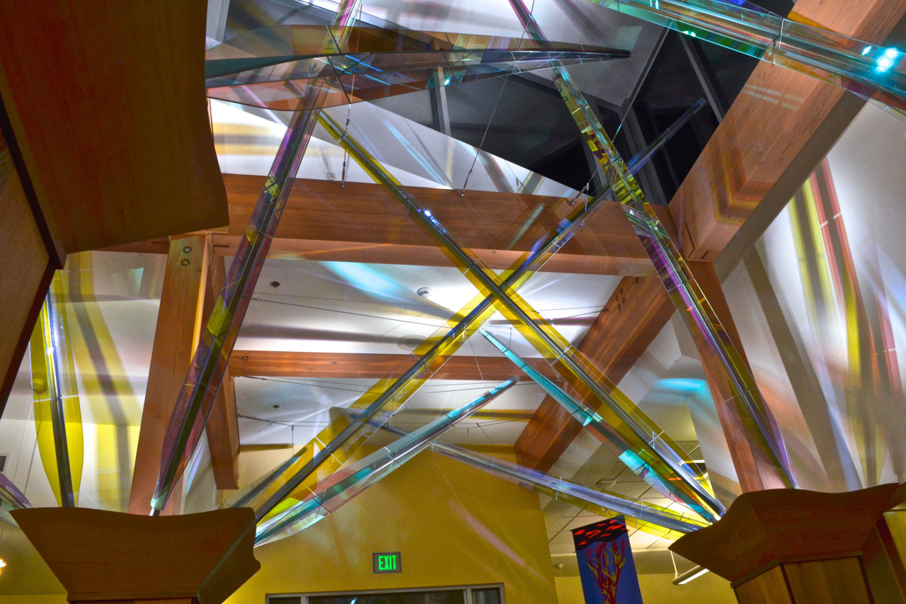 Mollie's Garden, Ed Carpenter's interior library sculpture dichroic panels colorfully play with the light both day and night. / image 3